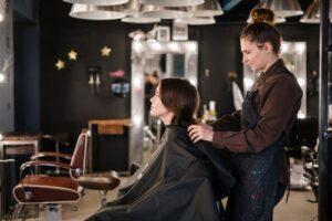 a woman getting a haircut